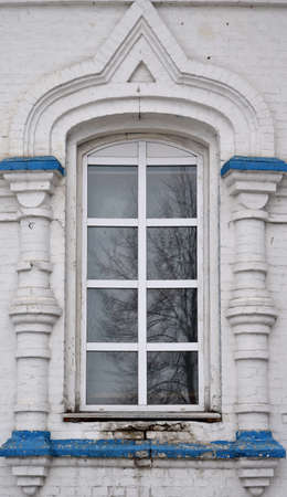 A large window in the church. Plastic