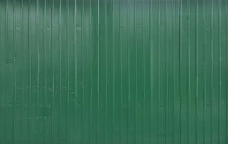 Green metal decking. Sheets of green corrugated iron
