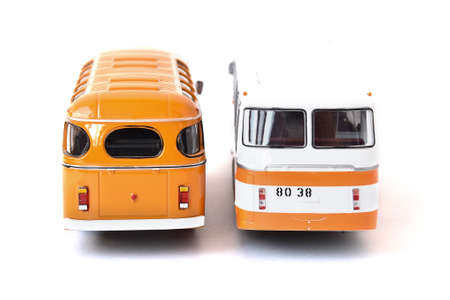 Scale model of a white and yellow Russian buses. Toy yellow bus