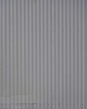 Gray metal decking. Sheets of gray corrugated iron