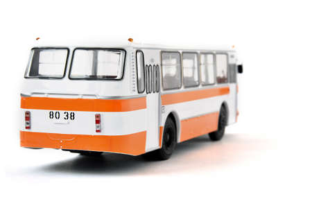 Scale model of a white yellow Russian bus. Toy yellow bus