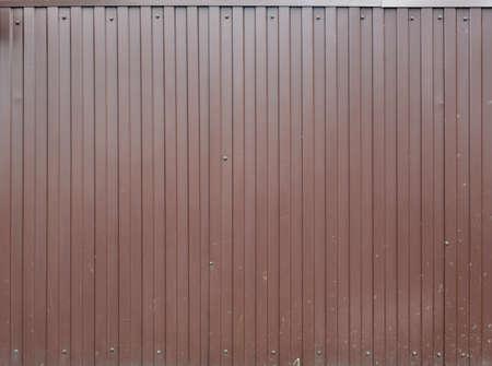 Brown metal decking. Sheets of blue corrugated iron. Reklamní fotografie