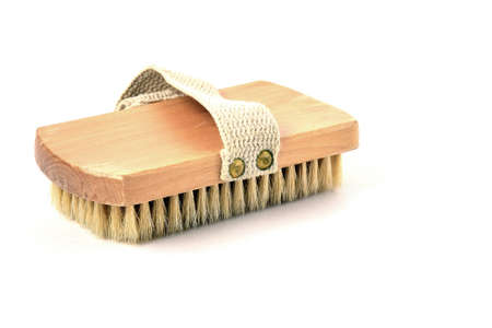 Beige body brush with itater handle on a white background