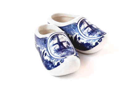 Blue and white porcelain shoes on a white background. Isolated object.