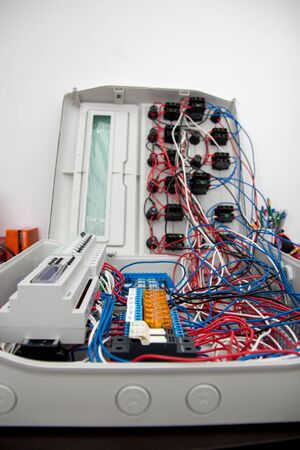 Assembly of automatic control panel. Information technology. Technology electrotechnical design. Engineering, futuristic, science communication concept. Digital technology background. Vertical image