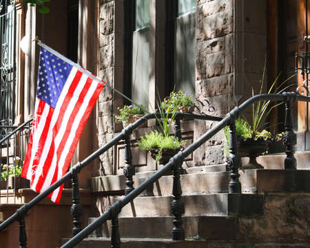 brownstone: A New York City Brownstone displaying the American flag Stock Photo
