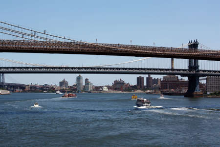 A sunny day in the Hudson River with boats, ferrys and water taxis Stock Photo