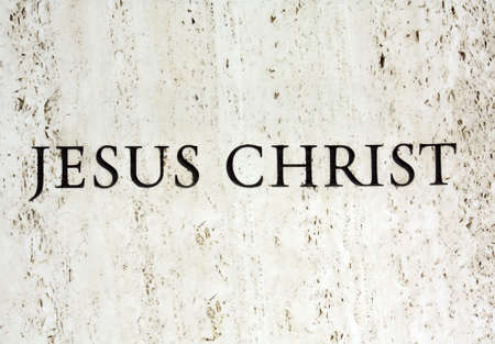 Jesus Christ carved into a slab of white marble photo