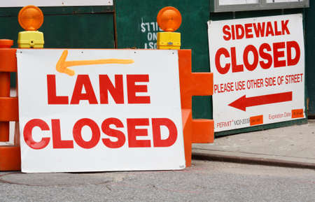 Detour Signs stating Lane Closed and Sidewalk Closed with detour directions