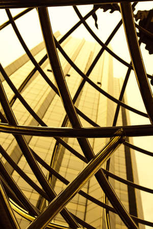 Sepia view of a luxury highrise through an open metal structure