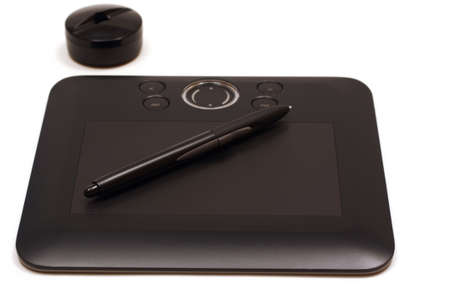 Illustrators tablet with pen for drawing vectors and 3D shapes on a white background
