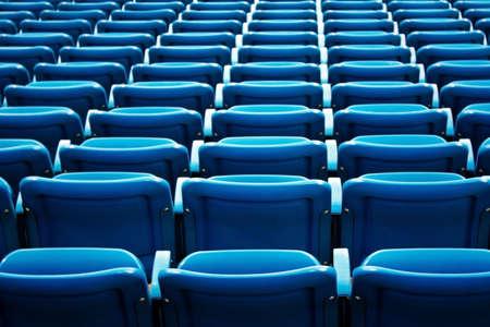 A full shot of blue stadium seats at the Arthur Ashe Stadium