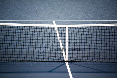net: Close up shot of the net of a tennis court at the US Open Stock Photo