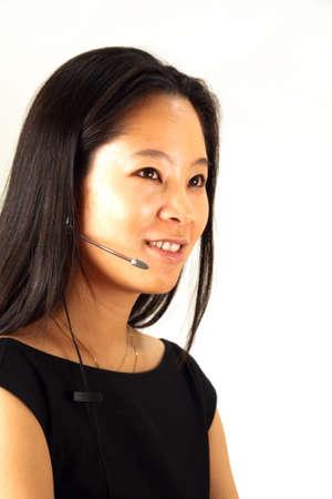 Asian Woman working in customer service, wearing a headset