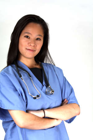Asian female doctor in scrubs, wearing a stethescope Stock Photo