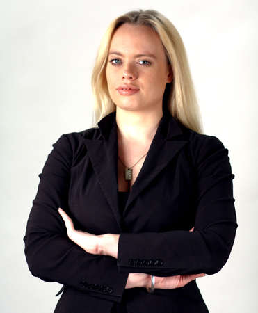 A confident blond business woman on a white background