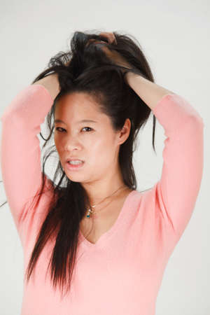 Sexy Asian woman playing with her hair