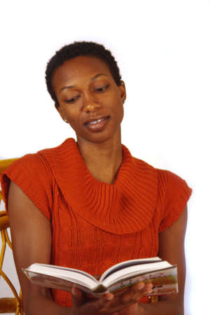 Beautiful African American woman reading a book