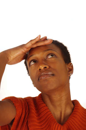 African American woman with hand on forhead Stock Photo
