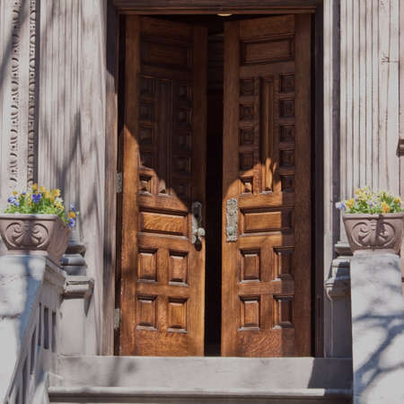 open front door of a nyc brownstone, with a welcoming feel  Stock Photo
