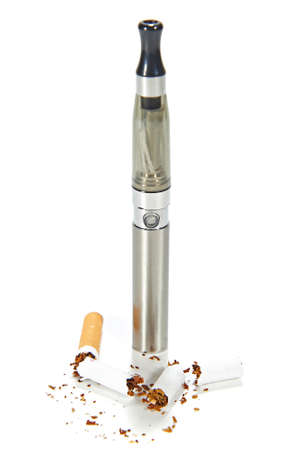 Electronic cigarette with broken real cigarettes around it photo