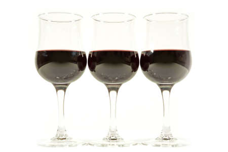 intense flavor: Red wine isolated on a white background Stock Photo