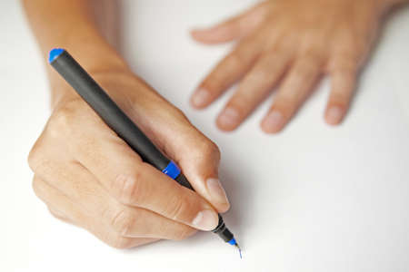 person writing: Closeup of a Person writing with ball pen Stock Photo