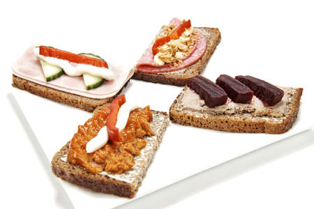 Danish Smørrebrød on a plate isolated on white photo