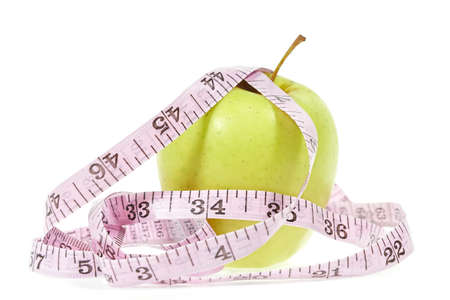 tapeline: An apple with messure tape illustrating a healthy lifestyle Stock Photo