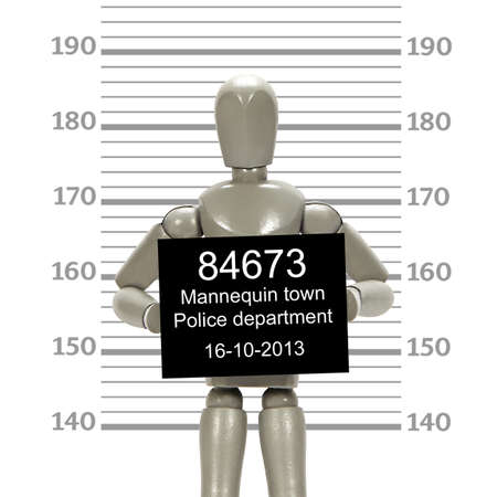 Grey mannequin posing in a mugshot
