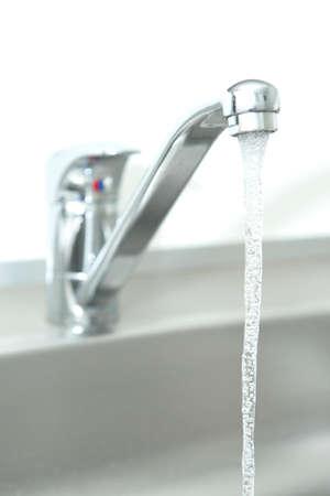 watertap: Closeup of a Running kitchen water tap
