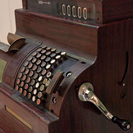 operated: Closeup of an antique crank operated cash register
