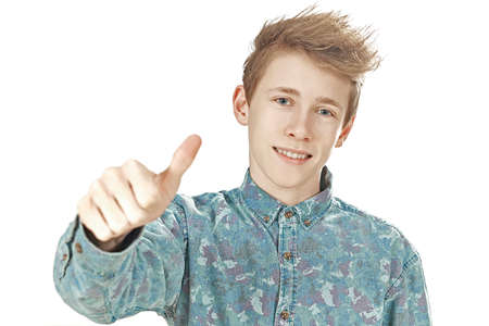 thumps up: Teenager gives thumps up and smiles on a white background