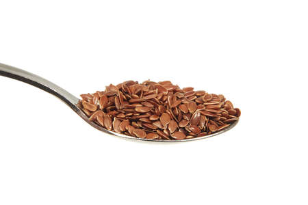 brown flax: Brown flax seeds on a teaspoon on a white background
