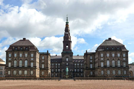 Christiansborg Palace in Copenhagen, Denmark with clouds and blue skies in the background