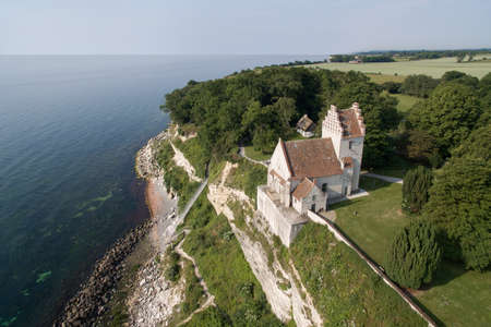 old church: Aerial view of Stevns cliff and Hoejerup Old Church located in Zealand, Denmark Stock Photo