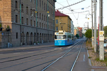 gothenburg: Street view in Gothenburg, Sweden with a blue tram driving Stock Photo