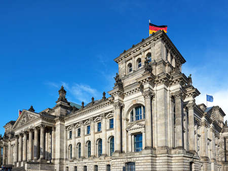 The Reichstag building in Berlin with blue skies in the background