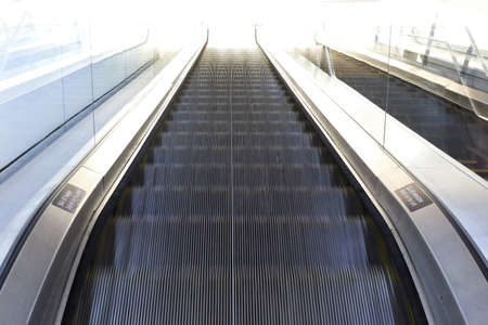 Moving escalator seen from the top with motion blur