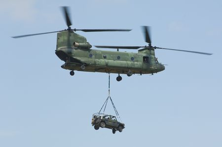 helicopter pilot: CH-47 Chinook helicopter carrying 4x4x off-road mercedes