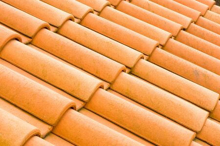 Loang red french roof tiles photo