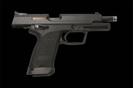9 mm pistol with breach open on black photo
