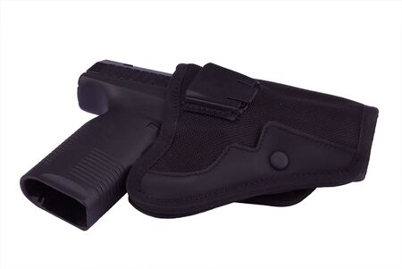 jacked: 9 mm pistol in holster isolated on white Stock Photo