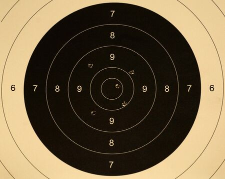 scored: Pistol 25 meter target with 5 holes, 47 scored