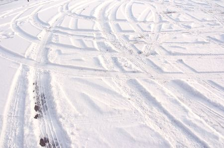 Car tire track in fresh light snow