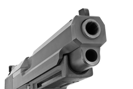 violence and trigger: Looking down the barrel of a large 9mm automatic pistol