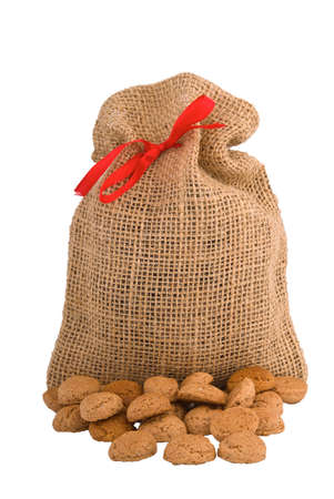 gingernuts: Bag for Pepernoten (gingernuts) Dutch biscuits specialty for Sinterklaas holliday Stock Photo