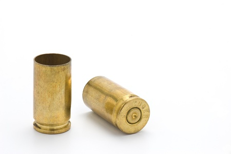 gun shell: Two used 9mm shell casings Stock Photo