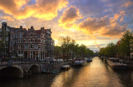 Canal in Amsterdam at sunset in summer, hdr photo