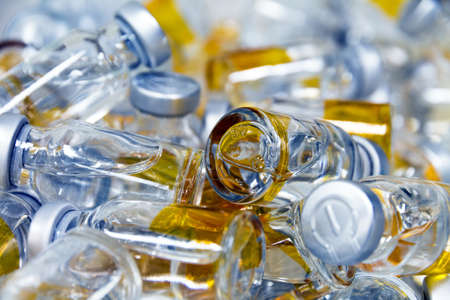 medicinal bottles on a pile photo